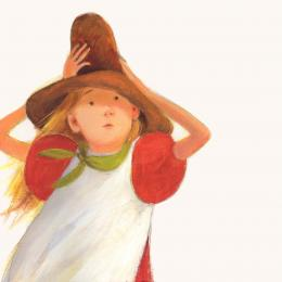 A girl wearing a red dress and white apron holding a brown hat on her head