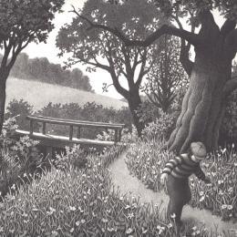 A young boy running along a garden path